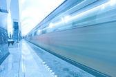 Modern illuminated metro station with train motion — Stock Photo