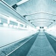Blue underground platform with moving train — Stock Photo