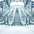 Stock Photo: Business hall with blue vanishing escalators