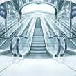 Business hall with blue vanishing escalators - Foto Stock