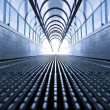 Symmetric escalator inside contemporary airport — Stock Photo