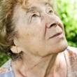 Stock Photo: Portrait of a dreaming senior woman outdoor