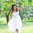 Adorable young girl in white clothes enjoying barefooted over mo - Stock Photo