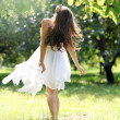 Beautiful young woman dancing in the morning bright summer orchard — Stock Photo #16958859
