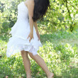 Beautiful young woman dancing in the morning bright summer orchard — Stock Photo #16959541