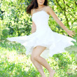 Beautiful young woman dancing in the morning bright summer orchard — Stock Photo #16959719