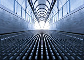 Symmetric escalator inside contemporary airport — Stockfoto