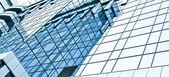 Vidrio panorámico rascacielos del centro de la ciudad, negocios de fondo — Foto de Stock