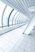 Airport interior, vanishing walkway with transparent wall — Stock Photo