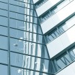Stock Photo: Dark textured pane of contemporary glass architectural building skysc