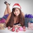 Attractive young girl with christmas vivid presents — Stock Photo