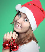 Cute young girl with christmas balls — Stockfoto