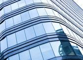 Blue glass wall of skyscraper — Stock Photo