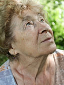 Portrait of a dreaming senior woman outdoor — Stock Photo