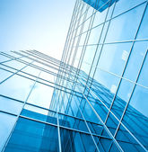 Blue glass high-rise corporate building — Stockfoto
