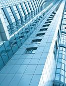 Moderna glas silhuetter av skyskrapor på natten — Stockfoto