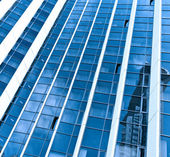 Contemporary striped black texture of glass architecture — Stock Photo