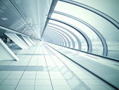 Wide angle view to dark steel tunnel in contemporary airport walkway — Stock Photo