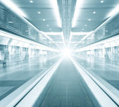 Futuristic escalator inside contemporary airport — Stock Photo