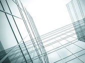 Transparent glass wall of contemporary skyscraper — Stock Photo