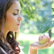 Gorgeous young girl with sappy apples - Stock Photo