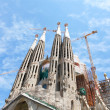 "BARCELONA SPAIN - JULY 25: ""La Sagrada Familia\"", the unrealistic cathedral designed by Gaudi, which is being build since 19 March 1882 with the donations of , on July 25, 2011 in Barcelona, Spai - Stock Photo"