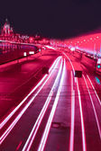 Night red motion on urban streets — Stock Photo
