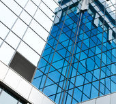 Contemporary blue pane of business building — Stock Photo