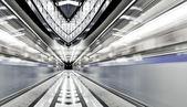 Vivid symmetric illuminated metro station with marble floor — Stock Photo
