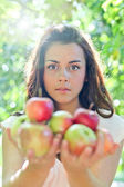 Gorgeous young girl with sappy apples — Стоковое фото