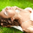 Portrait of Gorgeous young pretty brunette woman relaxing in sun — Stock Photo #18695759