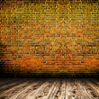 Empty black old spacious room with stone grungy wall and wooden - Stock Photo