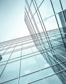 Blue glass high rise corporate building — Stock Photo