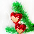 Red hearts hanging on Christmas fir tree — ストック写真
