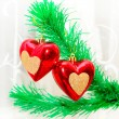 Red hearts hanging on Christmas fir tree — Foto de Stock
