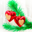 Red hearts hanging on Christmas fir tree — Stock fotografie