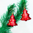 Branch of Christmas tree with colorful bauble hanging — Stock Photo