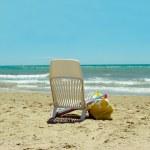 Chair under umbrella on beautiful beach — Stock Photo #25214965