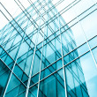 Transparent glass wall of office building — Stock Photo #25215153
