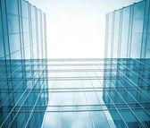 Contemporary blue glass wall of skyscraper — Stock Photo