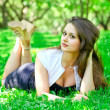Young womrelaxing in park — Stok Fotoğraf #25228535