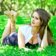 Young womrelaxing in park — Stock fotografie #25228535