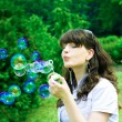 Girl with soap-bubbles — Stock Photo
