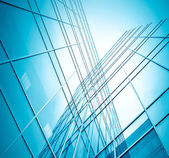 Glassy texture of tilt view to contemporary turquoise glass busi — Stock Photo