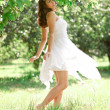Woman dancing in the orchard — Stock Photo