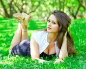 Woman in summer park — Stock Photo