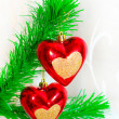 Red hearts hanging on Christmas fir tree — 图库照片