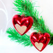 Red hearts hanging on Christmas fir tree — Стоковая фотография