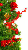 Christmas tree with colorful bauble hanging — Stock Photo