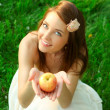 Young lady with sappy apple  — Stock Photo